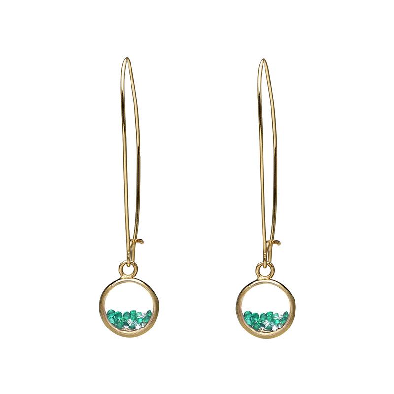 Boucles d'oreilles avec des diamants et des émeraudes